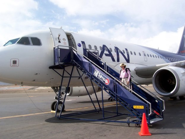 Jean boarding a Lan Airlines jet on the runway in Arequipa, Peruaircraft in Arequipa, Peru, South America