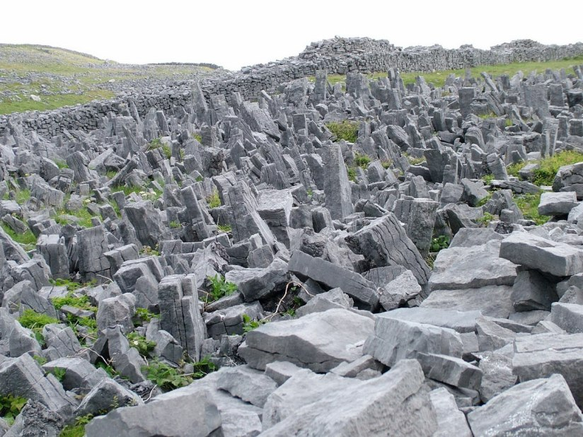 A closeup image of the defensive stone slabs around Dun Aonghasa Fort on Inishmore Island in Ireland. Photography by Frame To Frame - Bob and Jean.