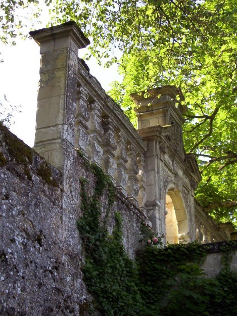 An image of a stone wall and gate at Chateau de la Bourdaisiere in the Loire Valley in France.