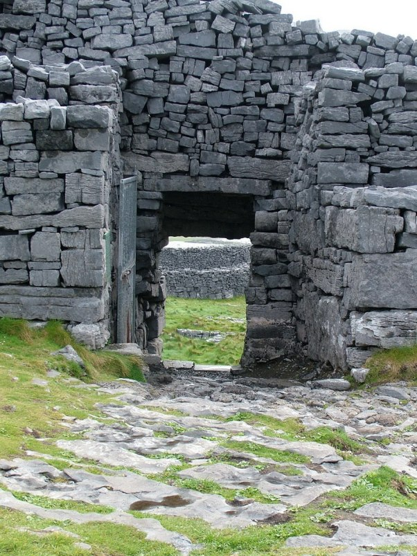 An image of a doorway in the stone walls of Dun Aonghasa Fort on Inishmore Island, in Ireland. Photography by Frame To Frame - Bob and Jean.
