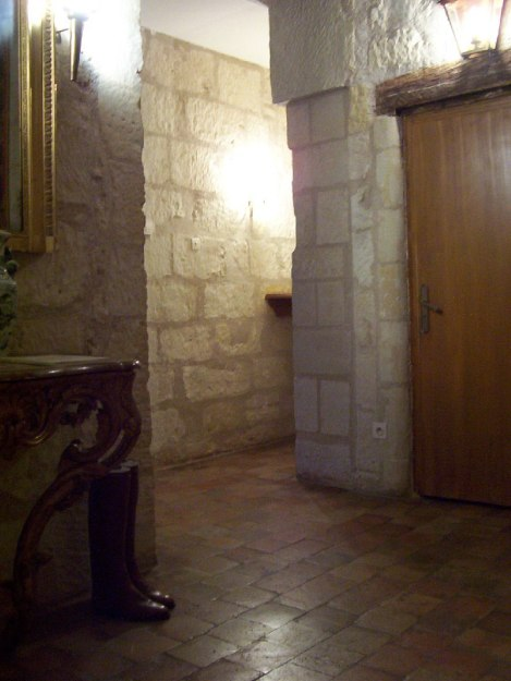 An image of a stone hallway at Chateau de la Bourdaisiere in the Loire Valley in France.