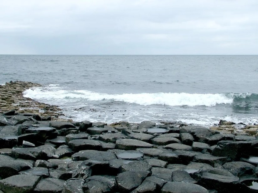 An image of the North Atlantic surf breaking on the hexagonal columns at Giant's Causeway, near Portrush, Northern Ireland. Photography by Frame To Frame - Bob and Jean.