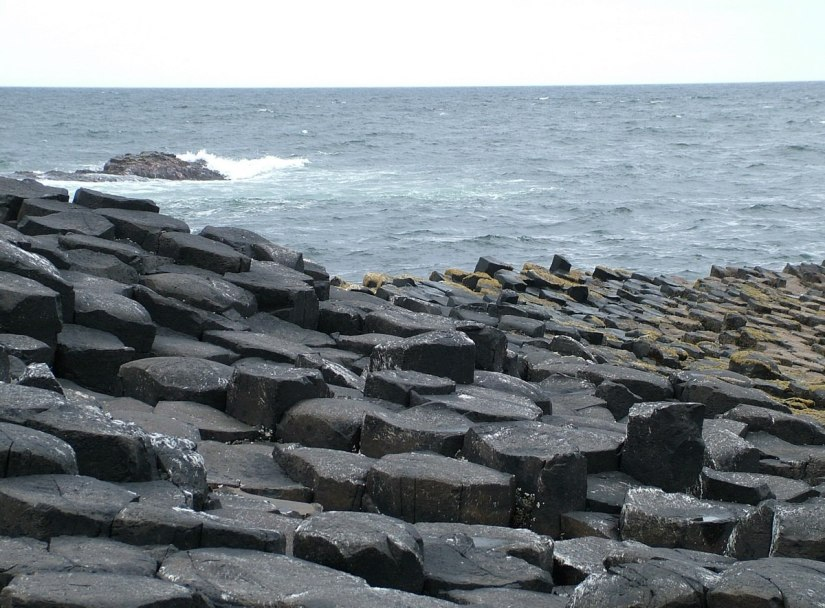 An image of the hexagonal basalt columns beside the ocean shore at the Giant's Causeway, near Portrush, Northern Ireland. Photography by Frame To Frame - Bob and Jean.