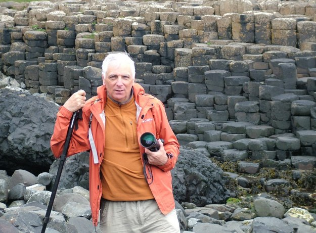 An image of Bob standing among the hexagon basalt columns at the Giant's Causeway, near Portrush, Northern Ireland. Photography by Frame To Frame - Bob and Jean.