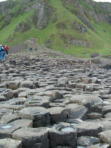 An image of rain water on the hexagonal basalt columns at the Giant's Causeway, near Portrush, Northern Ireland. Photography by Frame To Frame - Bob and Jean.