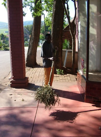 Sidewalk cleaner in Sabie, South Africa
