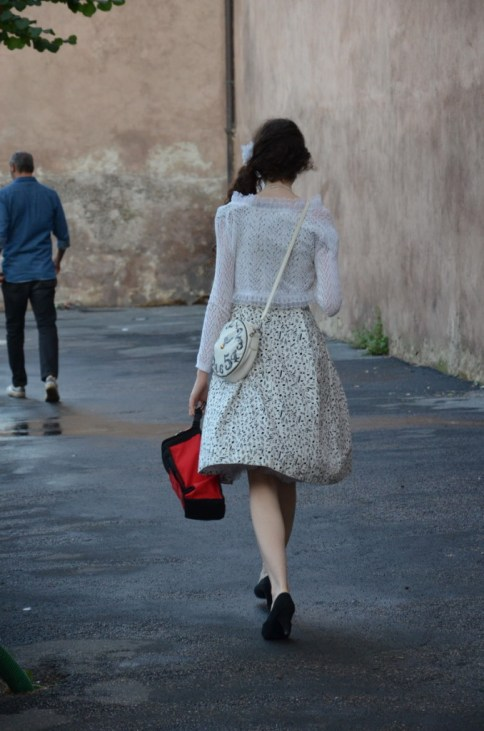 Young woman walking in fashionable clothing in Rome, Italy