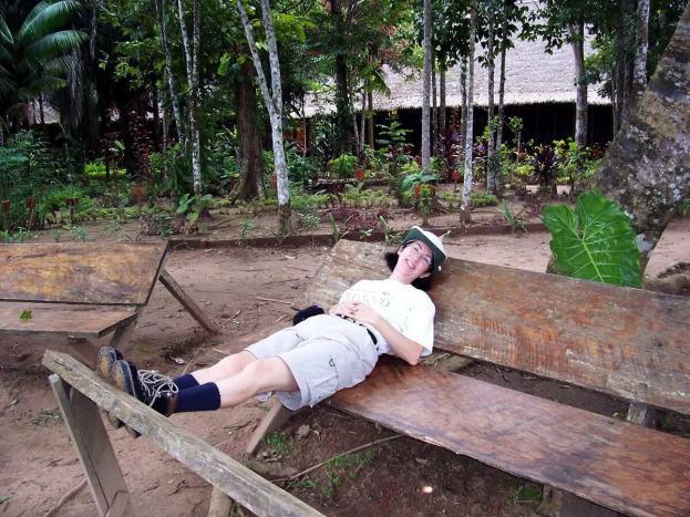 Jean sitting on a bench at Sandoval Lake Lodge, Lake Sandoval, Amazon Delta, Peru
