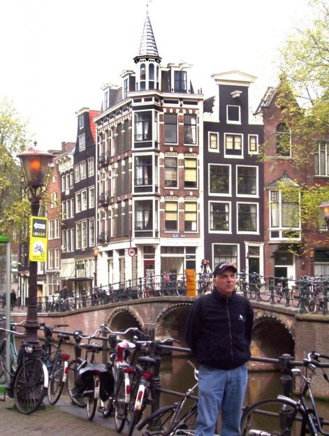 bikes on a canal bridge in amsterdam the netherlands