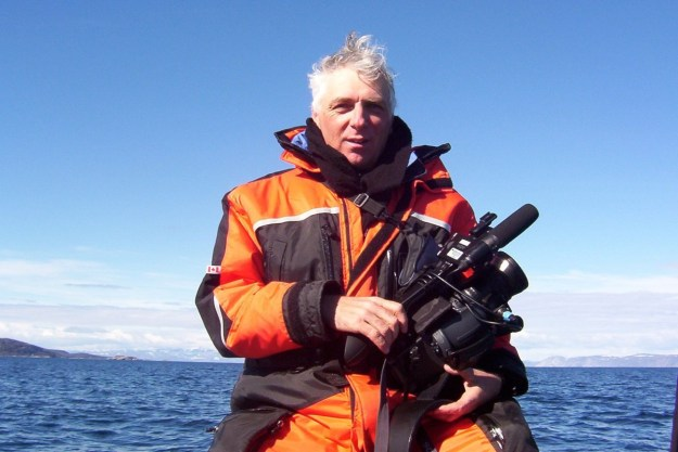 photograph of bob with his film camera off Kekerten Island, Nunavut, Canada