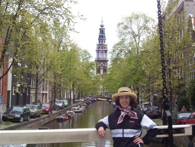 jean standing on a canal bridge in amsterdam
