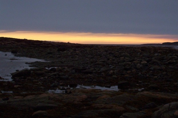 photograph of midnight in Nunavut, the land of the midnight sun, Canada.