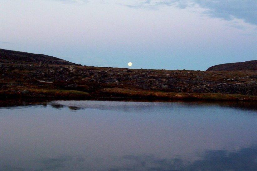 midnight sun on kekerten island, nunavut, canada