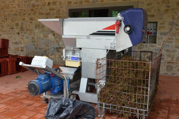 grape crusher at il colombaio di cencio vineyard, gaiole in chianti, itay