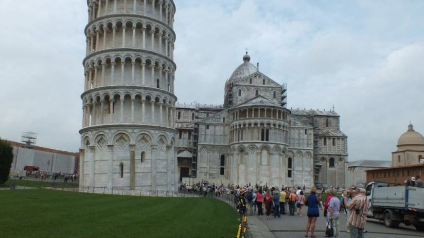 An image of people standing below the Leaning Tower of Pisa in Pisa, Italy. Photography by Frame To Frame - Bob and Jean