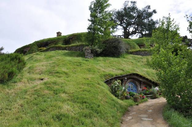 An image looking up towards Bilbo Baggins home high atop Bag End at Hobbiton in New Zealand. Photography by Frame To Frame - Bob and Jean.