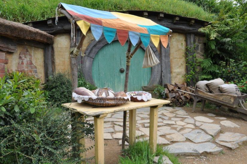 An image of the bread for sale out front of the bakers hobbit hole at Hobbiton in New Zealand. Photography by Frame To Frame - Bob and Jean.