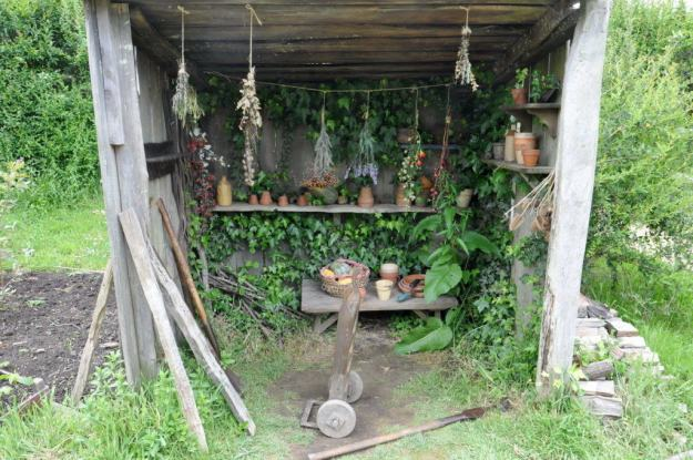 An image of a herbs drying in a wood shed hobbit hole beside a hobbit hole at Hobbiton in New Zealand. Photography by Frame To Frame - Bob and Jean.