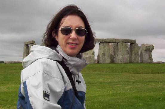 An image of Jean standing in front of Stonehenge in Wiltshire, England. Photography by Frame To Frame - Bob and Jean