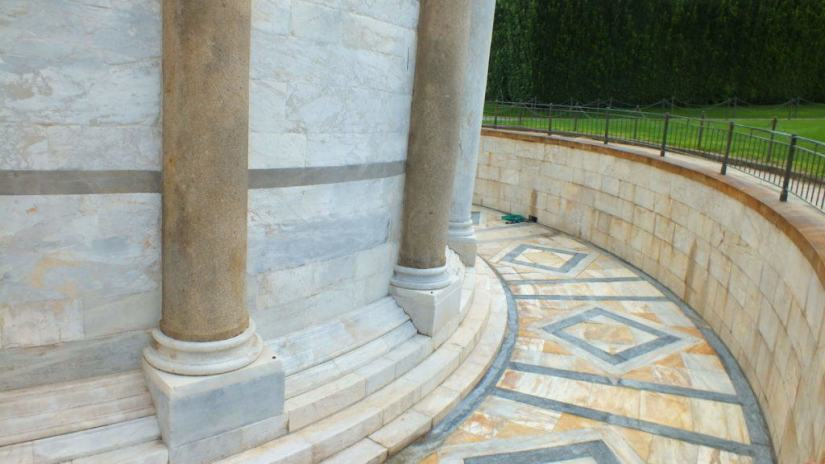 stone work at the base of the leaning tower of pisa, pisa, italy