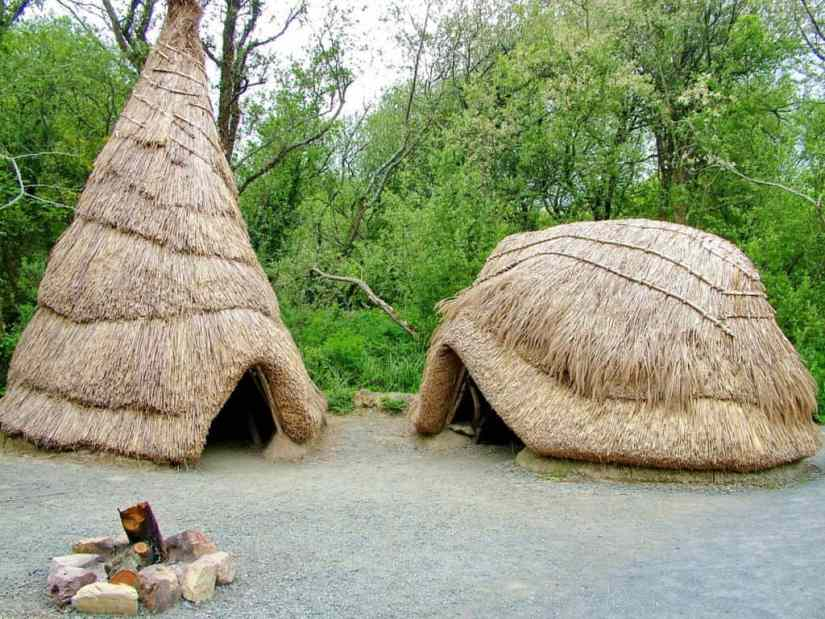 recreated thatched huts at Irish National Heritage Park in Ireland