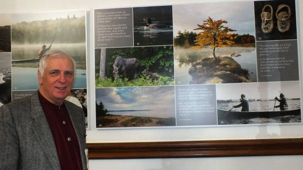 an image of Bob in front of his photo featured in 150 Stories, Toronto, Ontario, Canada