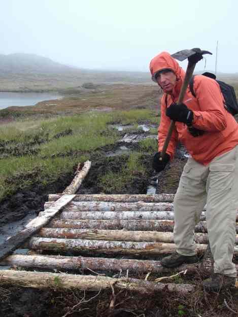 trail repairs on quirpon island, newfoundland, canada