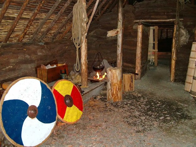 interior of a re-created Viking longhouse at l'anse aux meadows, newfoundland, canada