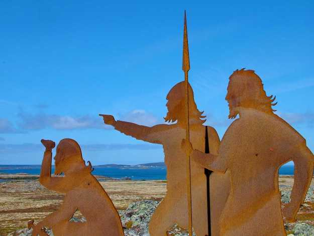 An image of the metal silhouette statue of period Norsemen with weapons at l'anse aux meadows, newfoundland, canada. Photography by Frame To Frame - Bob and Jean.