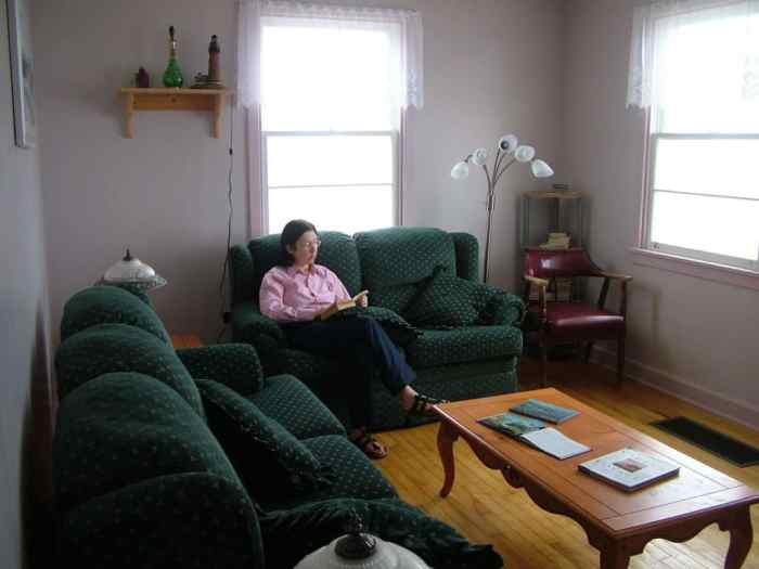 jean relaxing in the guest house, quirpon lighthouse inn, quirpon island, newfoundland, canada