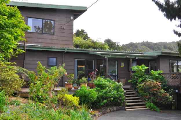 An image of Lone Kauri Lodge in the Waitakere Hills near Auckland, New Zealand.