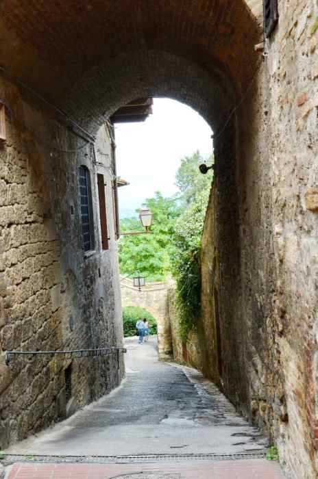 Image of a laneway inside San Gimignano, Italy.