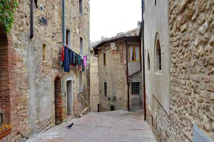 Image of laundry hanging in a laneway in San Gimignano, Italy.