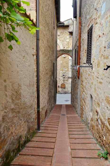 Image of a narrow roadway in San Gimignano, Italy.