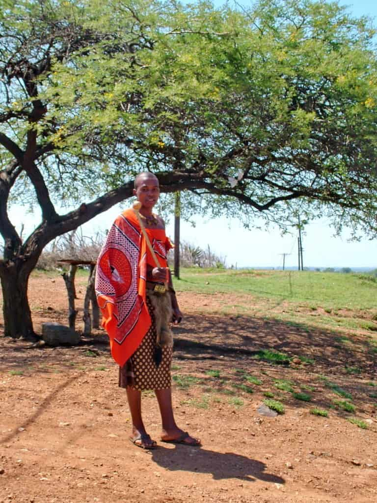 a young man in traditional dress in swaziland, africa