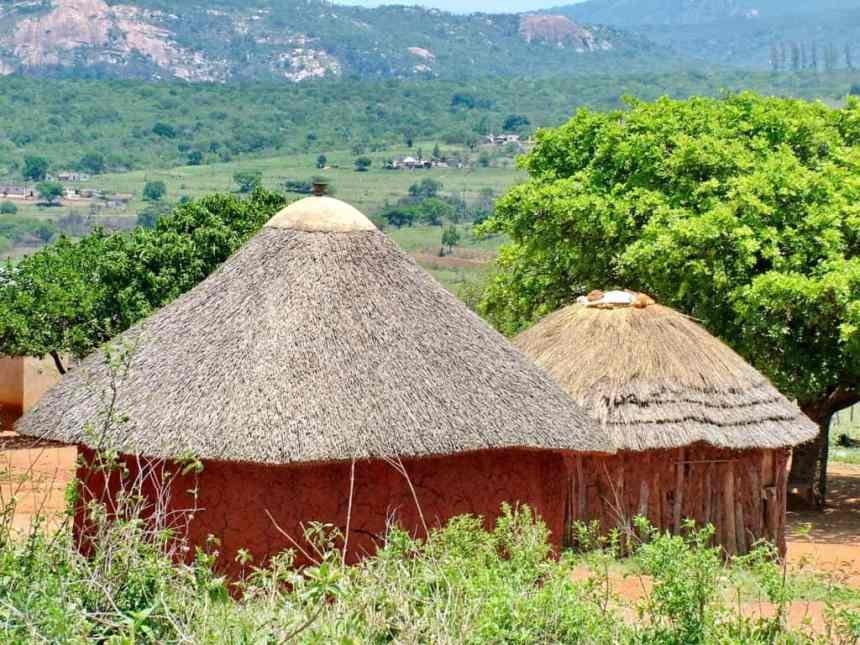 dwellings with a cone-shaped grass roof in swaziland, africa