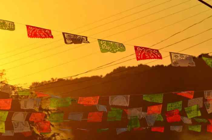 Image of ornate paper bunting at dusk in La Bajada, Mexico.