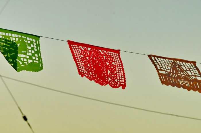 Image of ornate paper bunting at dusk in La Bajada, Mexico