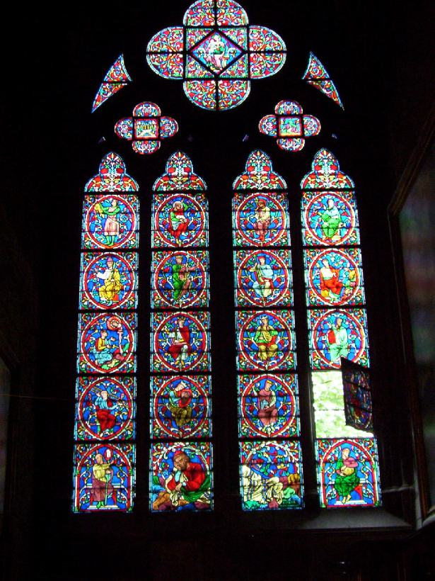 stained glass window inside notre dame cathedral, paris, france