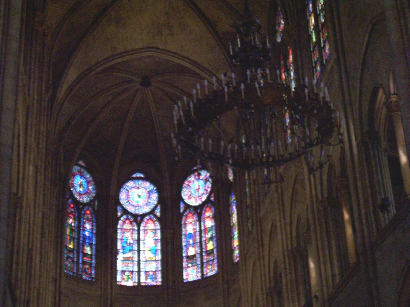 stained glass windows inside notre dame cathedral, paris, france