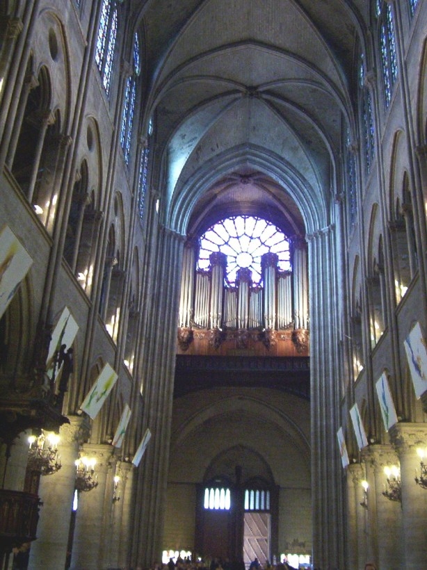 the nave inside notre dame cathedral, paris, france
