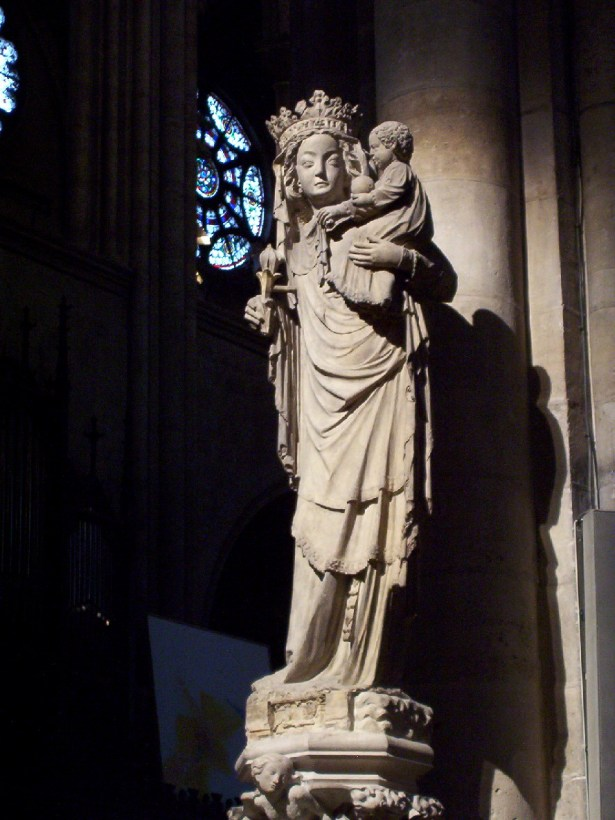 statue of virgin and child inside notre dame cathedral, paris, france