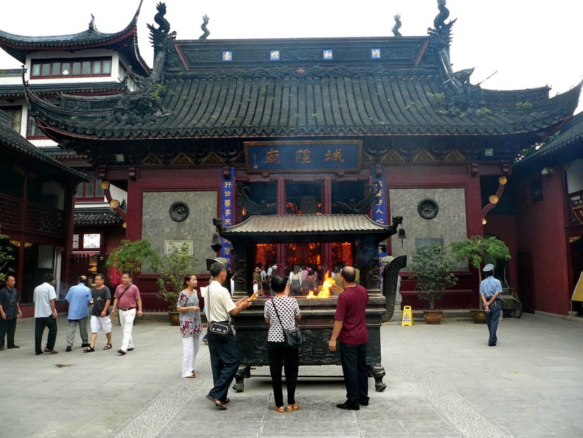 People in the main courtyard of the City God Temple of Shanghai, in Shanghai, China.