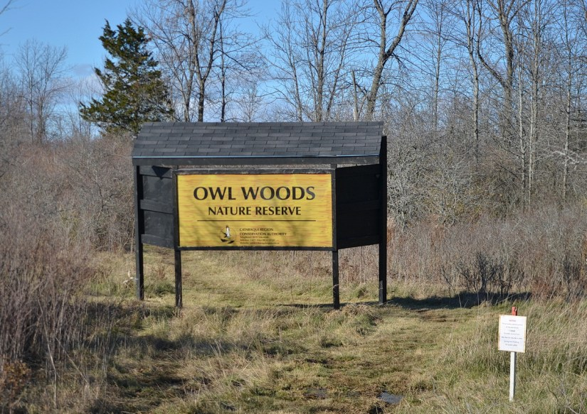 The Owl Woods Nature Reserve entrance sign on Amherst Island, Ontario, Canada.