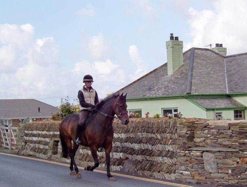 a horseback rider, tintagel, cornwall, england