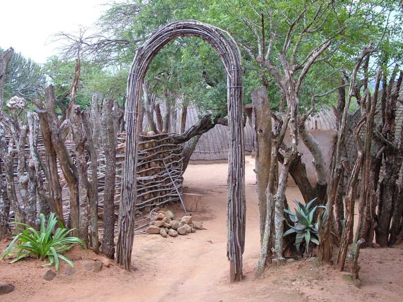 arch and fencing inside the kraal, shakaland, kwazulu-natal, south africa