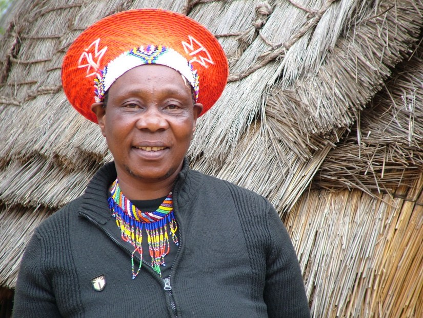 a married zulu woman wearing an izicolo, shakaland, kwazulu-natal, south africa