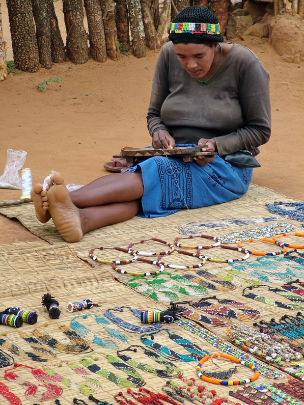 a zulu woman doing beading, shakaland, kwazulu-natal, south africa