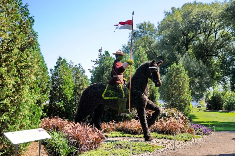 a royal canadian mounted police on horseback, mosaiculture 2018, gatineau, quebec, canada