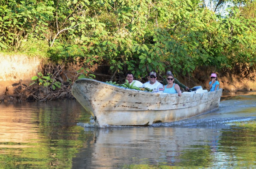 villagers with a boatload of plantain, cano negro wildlife refuge, costa rica